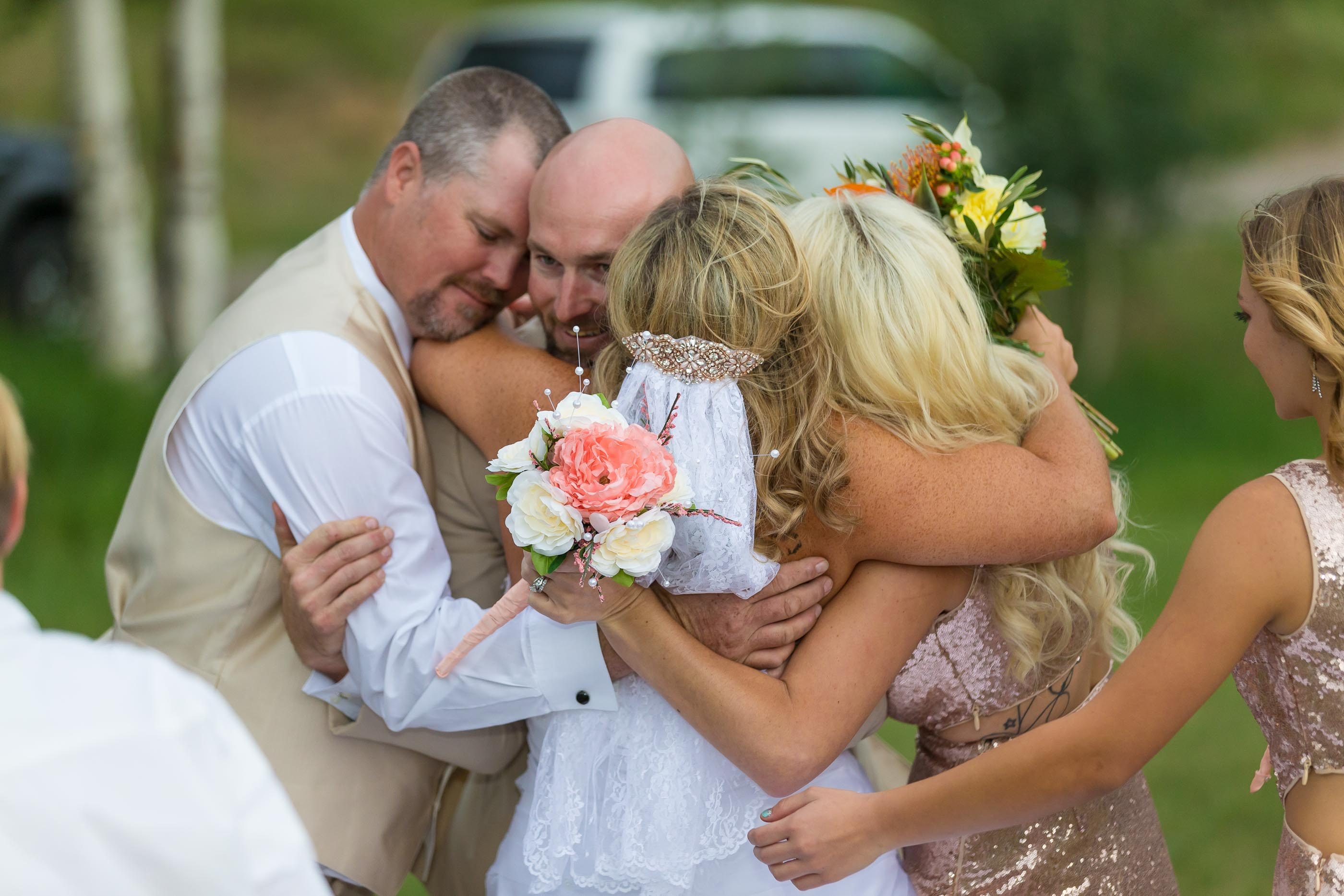 Family hug at this high mountain wedding