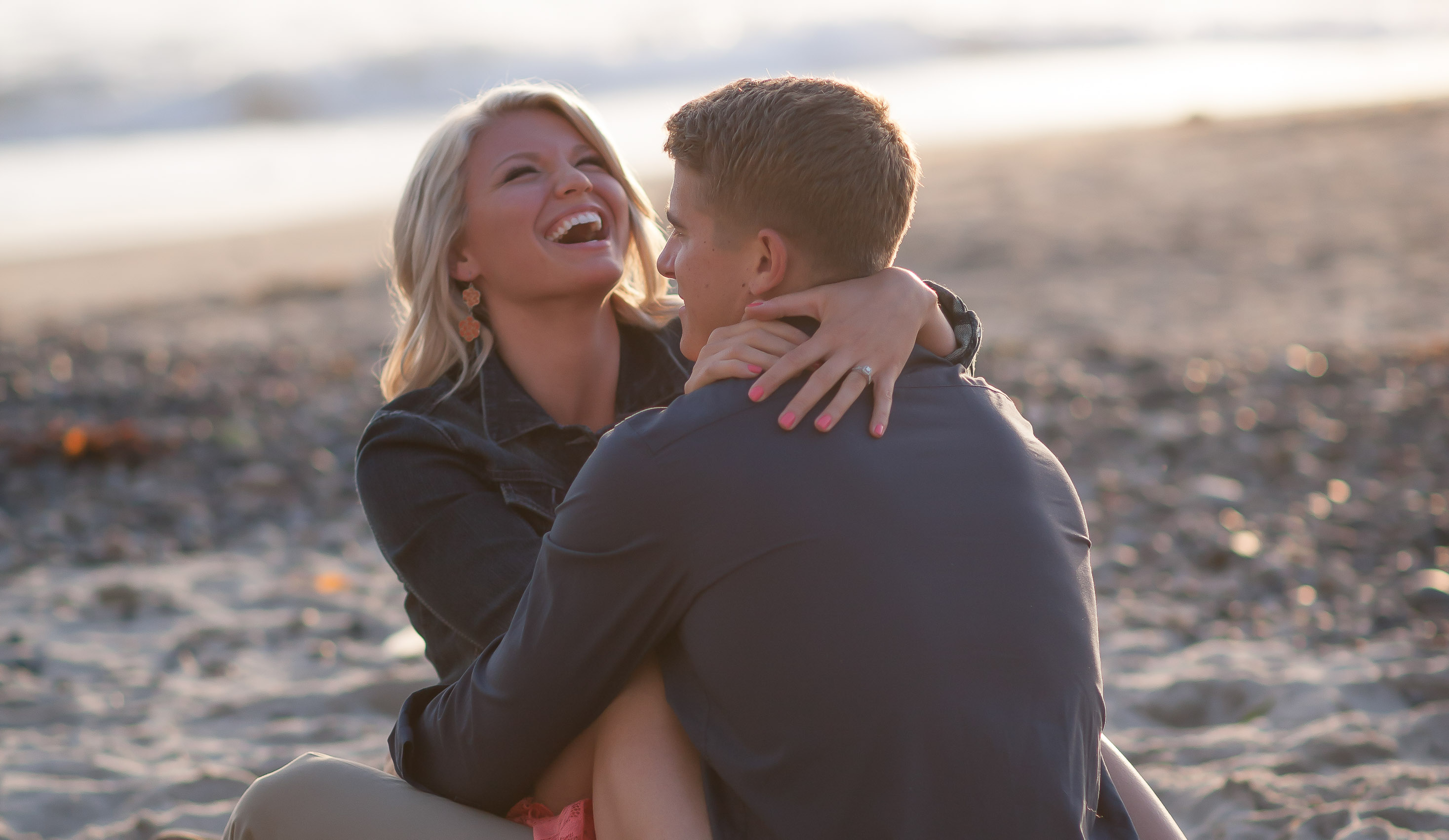 Sensual embrace during Engagement Images on San Clemente Pier Danielle and John Galloup