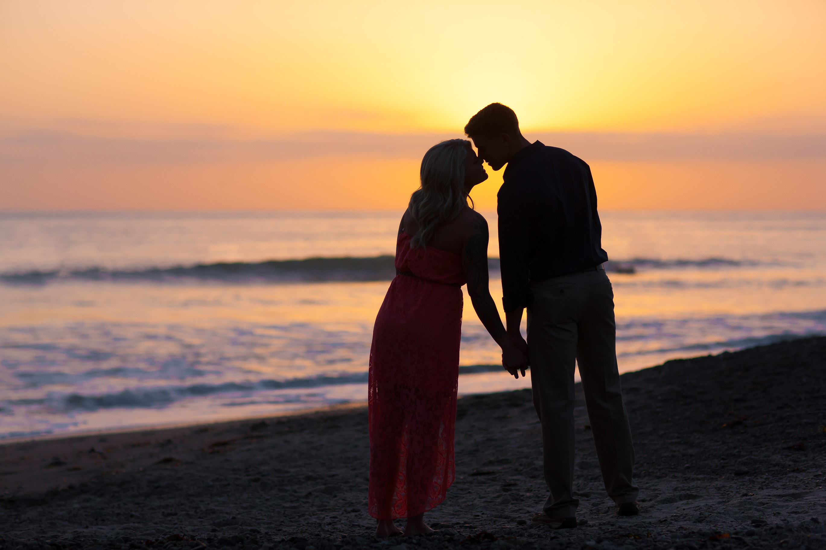Sunset Kiss Engagement Images San Clemente Pier Danielle and John Galloup