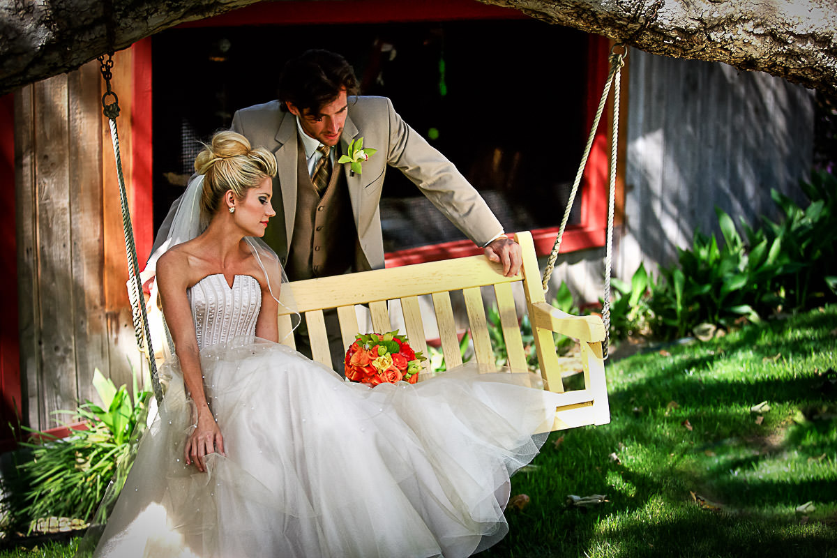 Bride and Groom at the swing Rancho Las Lomas Resort