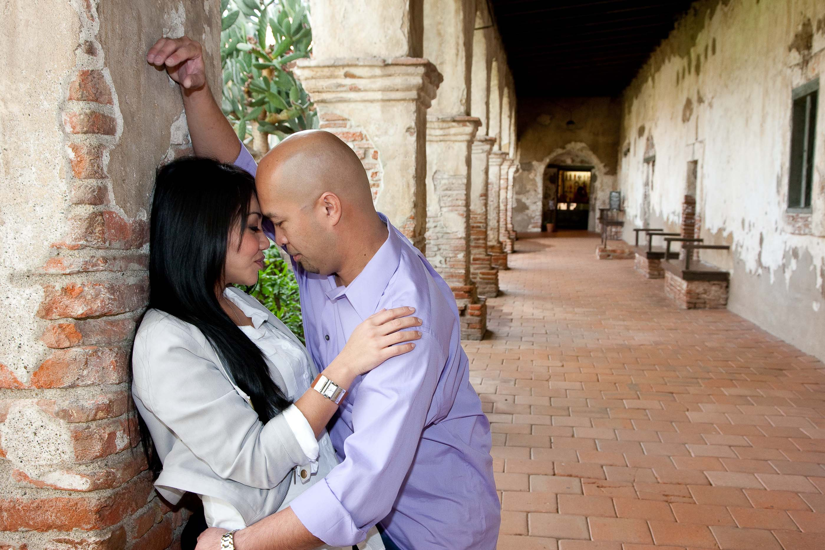 Romantic snuggle at the San Juan Capistrano Mission